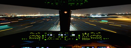 2015_planet_AIRPLANES_Cockpit_Night_Landing.jpg